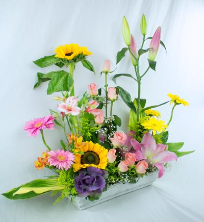 Jardinera primavera girasol rosas y gerberas