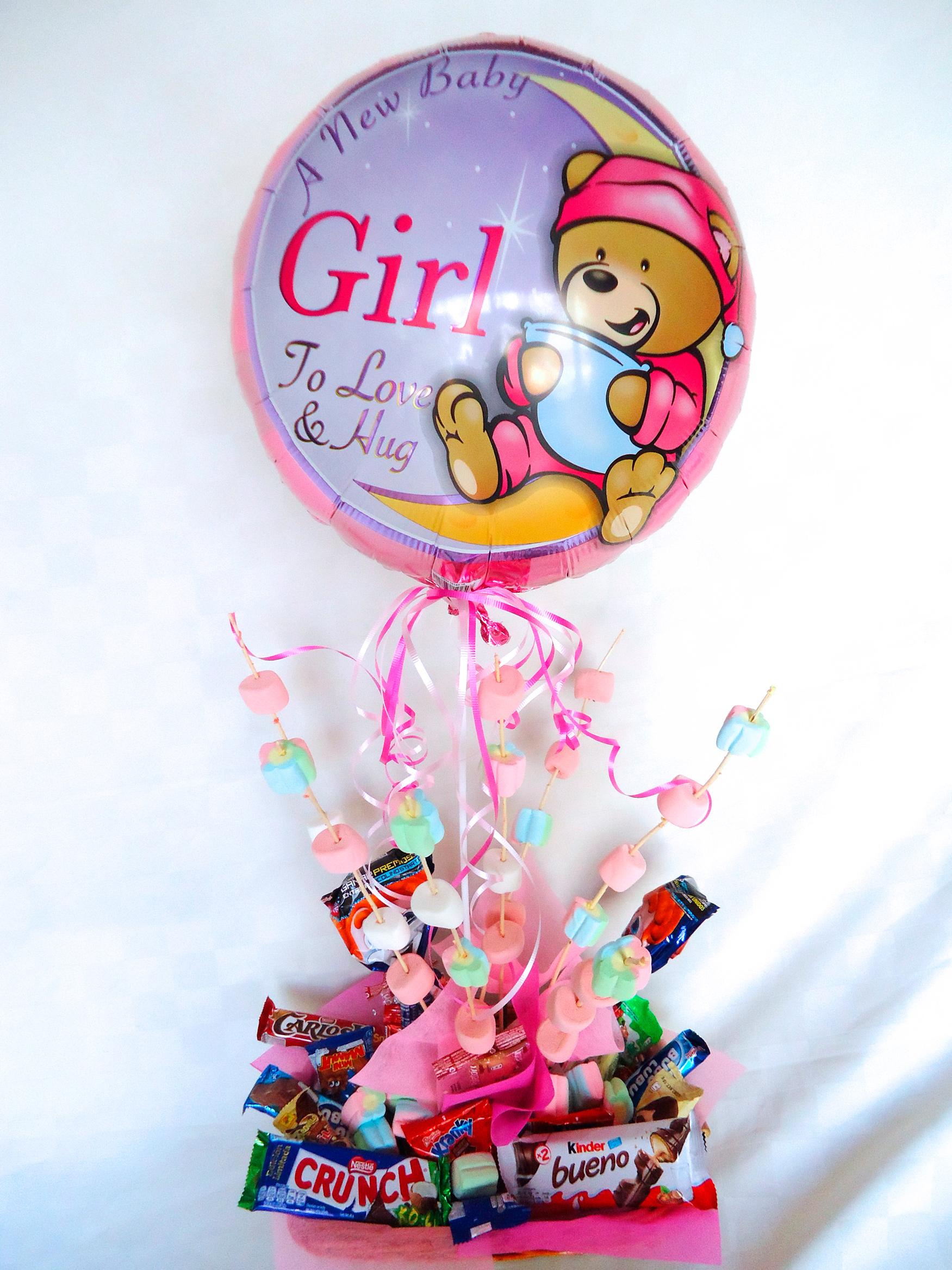 Canasta de dulces y globos